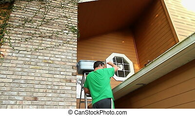 Cleaning Gutters Home Maintenance - 30s Adult Male Cleaning...