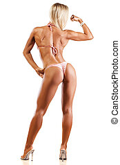 Fitness girl - rear view of pretty muscular girl posing on...