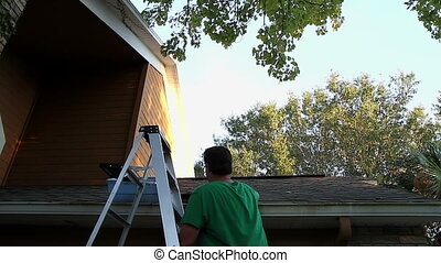Cleaning Gutters Time Lapse - 30s Caucasian Adult Male...