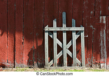 Old red barn wood with white gate - An old white gate leans...