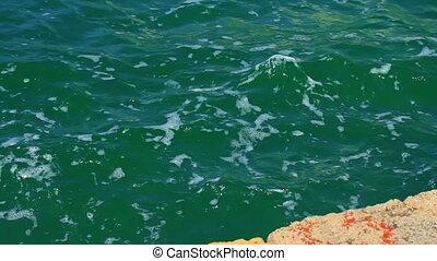 Sea wave at berth