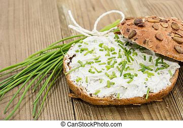 Fresh Creme Cheese on a roll topped with Chives