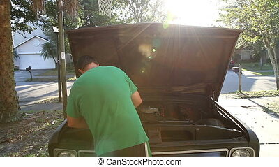 Working on classic truck in driveway DIY mechanic