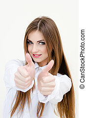 Young business woman wearing man's shirt showing thumbs up