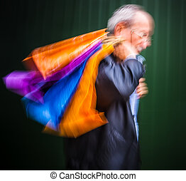 Holiday sales Man with many shopping bags in his hand...