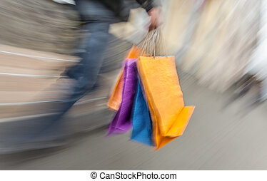 Holiday sales. Man with many shopping bags in his hand....