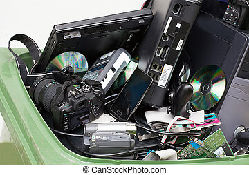Electronics in dustbin - Closeup of an electronics in green...