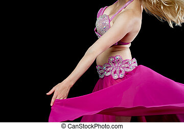 Belly dancer in action, cropped image - Cropped image of a...