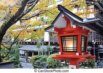 The view of autumn Japanese garden with maple