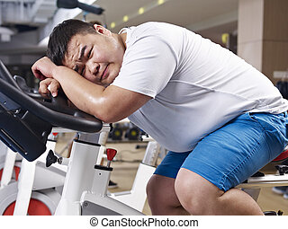 overweight man exercising - an overweight young man...