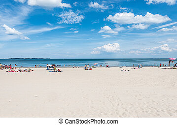 Summer scene at a public beach - Summer scene of a large...