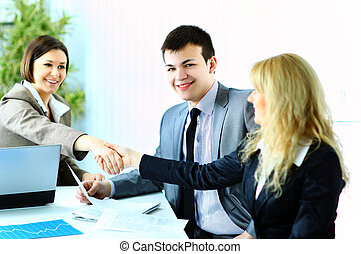 Image of business handshake after making an agreement in...