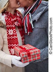 Christmas surprise - Image of amorous guy giving his...