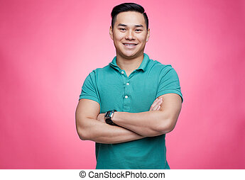 Happy guy - Smiling guy looking at camera on pink background