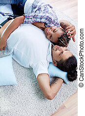 Home rest - Image of young guy and his girlfriend relaxing...