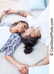 Devotion - Image of young guy and his girlfriend lying on...