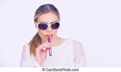 Woman smoking an e-cigarette - Woman in trendy stylish...