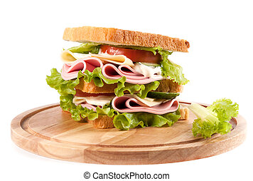 sandwich - big sandwich with fresh vegetables on wooden...