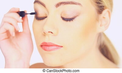 beauty woman applying mascara
