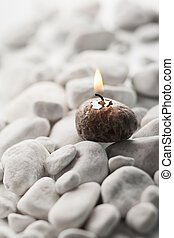 Spa concept  - Burning candle and white stones