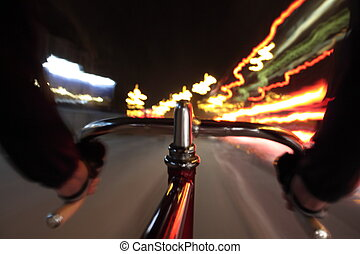 Cycling by night - Long exposure taken from a camera fixed...