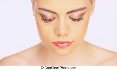 Beautiful young woman blinking - Beautiful young woman...