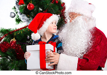 Old Santa Clause and young little boy holding gift box...