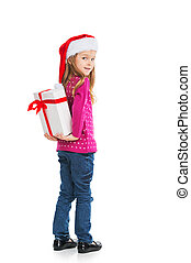 Small blond girl hiding big present behind back. Looking at...