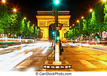 Evening on Champs-Elysees in front of Arc de TriompheParis...