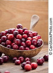 Cranberries - Cranberries in wooden bowl on wooden...