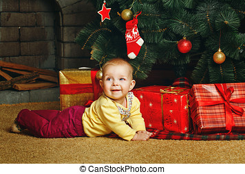 Baby gifts and Christmas tree - Redhead babe with blue eyes...
