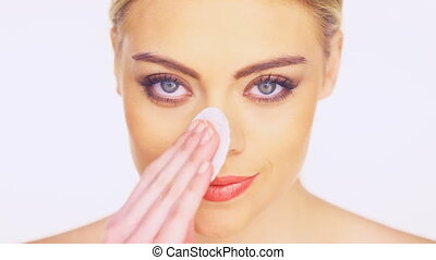 woman cleansing her face - Beauty portrait of a gorgeous...