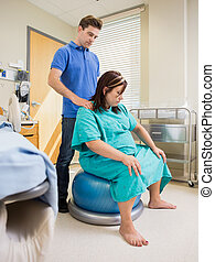Pregnant Woman in Hospital Using Exercise Ball - Pregnant...