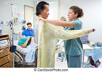 Doctor Preparing to Deliver Baby in Hospital - Mid adult...