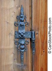 Iron hinge on the door