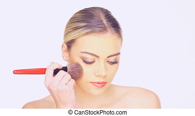 Woman applying blusher - Beautiful young woman with a lovely...