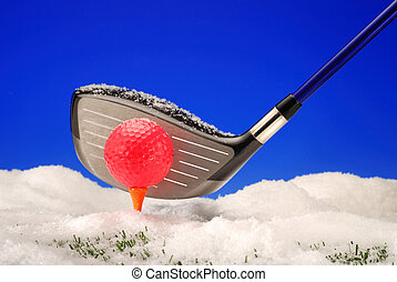 Golf in winter snow - Golf driver with brightly colored golf...