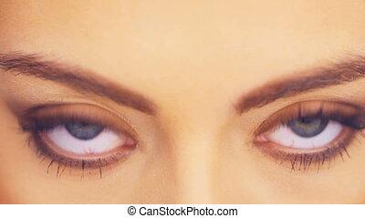 Beautiful young woman blinking