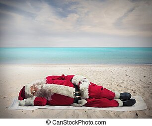 Santa Claus holiday - Santa Claus sleeping at the hot beach