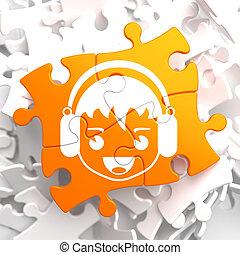 Happy Boy with Headphones Icon on Orange Puzzle.