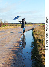 Running woman. - Hasty woman on rural road.