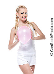 Sexy cute blond girl holding pink balloon and smiling...