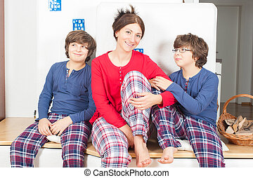 Family in pajamas - The European family, mother and two...