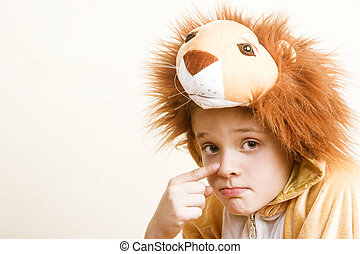 Halloween Costume - Playful young boy wearing a lion costume
