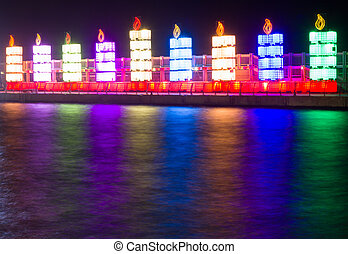 Hanukkah lights - The Jewish holiday of Hanukkah. Menorah in...