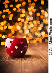 Candlestick. - Candlestick on a wooden table and background...