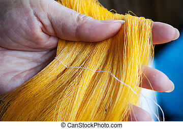 Process of weaving, dyeing, weaving ancient Thailand as silk