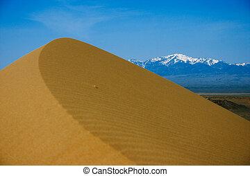 Sand dunes in desert national park Altyn-Emel, Kazakhstan.