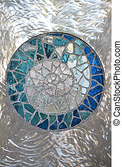 Stained Glass 2 - Stained glass against a brushed metal...