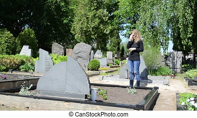 woman cross cemetery - Sad woman stand crossing and praying...